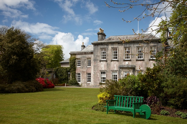 Trewithen House exterior with bench